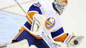 New York Islanders goalie Dwayne Roloson stops the puck during the first period of an NHL hockey game against the Washington Capitals, Wednesday, Oct. 13, 2010, in Washington. (AP Photo/Nick Wass)