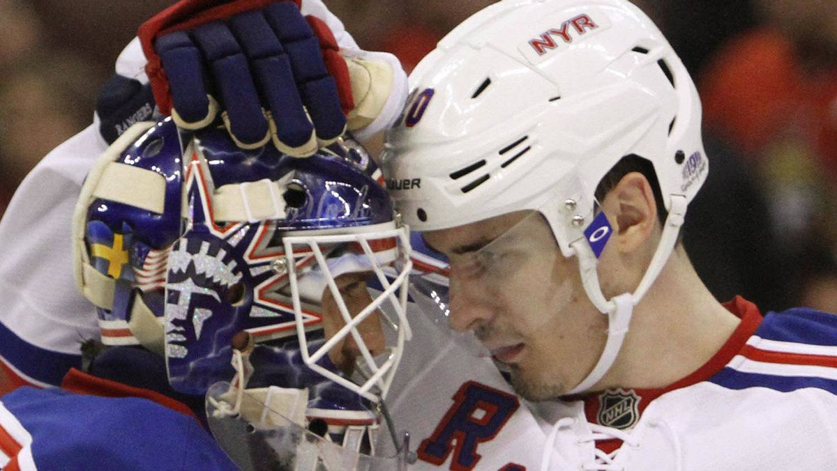 New York Rangers Brad Richards (19)and Chris Kreider (20) celebrate their win with goaltender Henrik Lundquist (30) after beating the Ottawa Senators 3-2 during game six of first round NHL Stanley Cup playoff hockey action at the Scotiabank Place in Ottawa on Monday, April 23, 2012. THE CANADIAN PRESS/Fred Chartrand