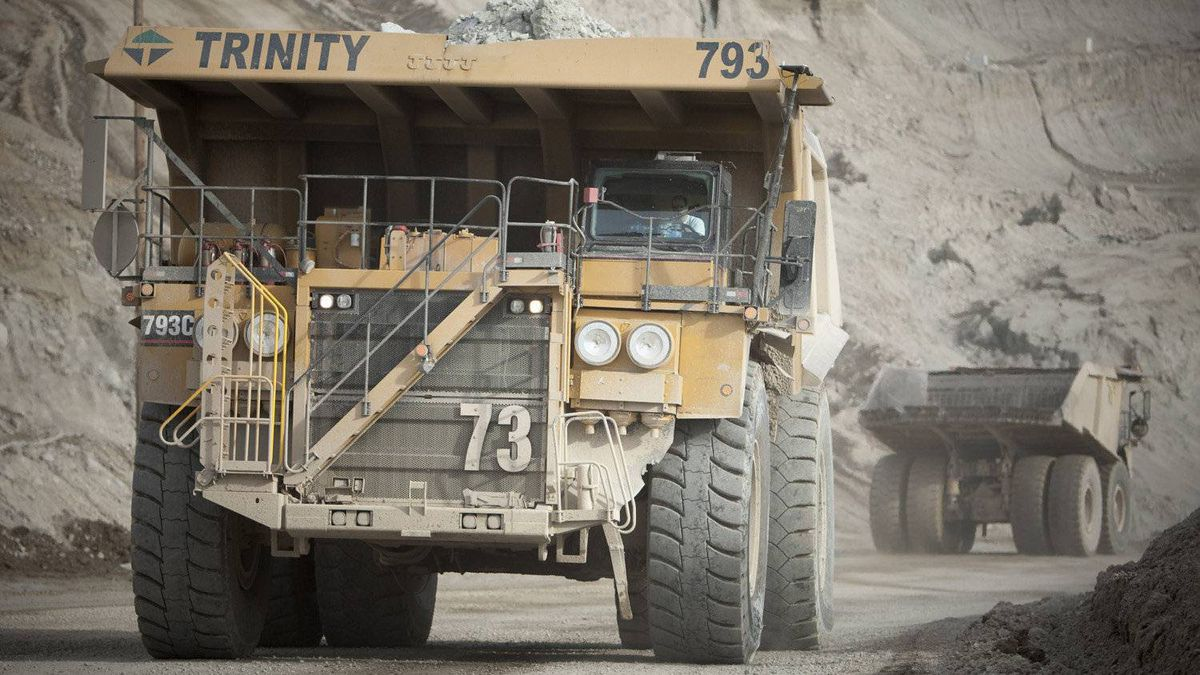 Dump trucks move waste rock around the Highland Valley Copper Mine in British Columbia.