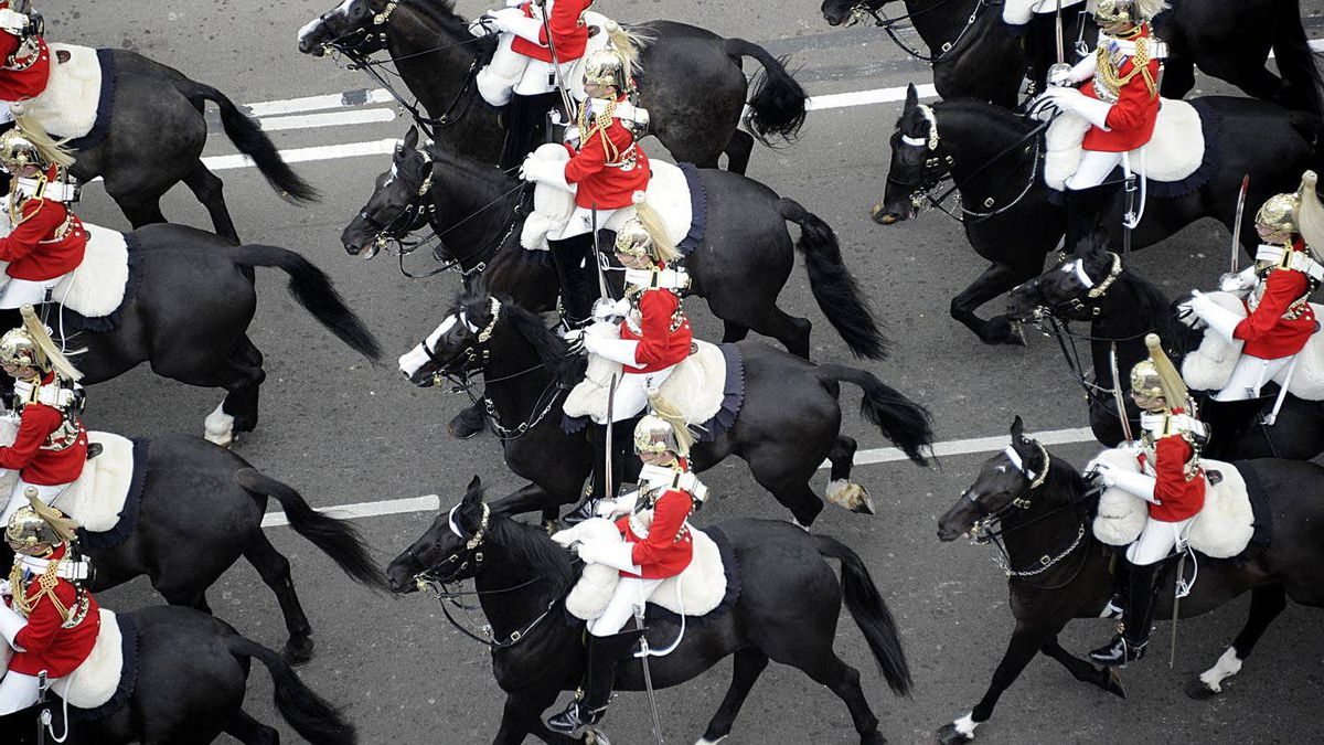 Members of the Household Cavalry mounted regiment travel along the Processional Route to Buckingham Palace, in London, on April 29, 2011.