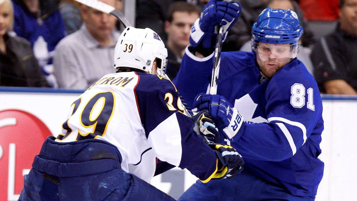 Toronto Maple Leafs forward Phil Kessel tries to get past Atlanta Thrashers defenseman Tobias Enstrom during the second period of their game in Toronto on March 30, 2010.