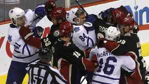Toronto Maple Leafs players (in white) and Phoenix Coyotes players fight during the second period of their NHL hockey game in Glendale, Arizona, January 13, 2011.