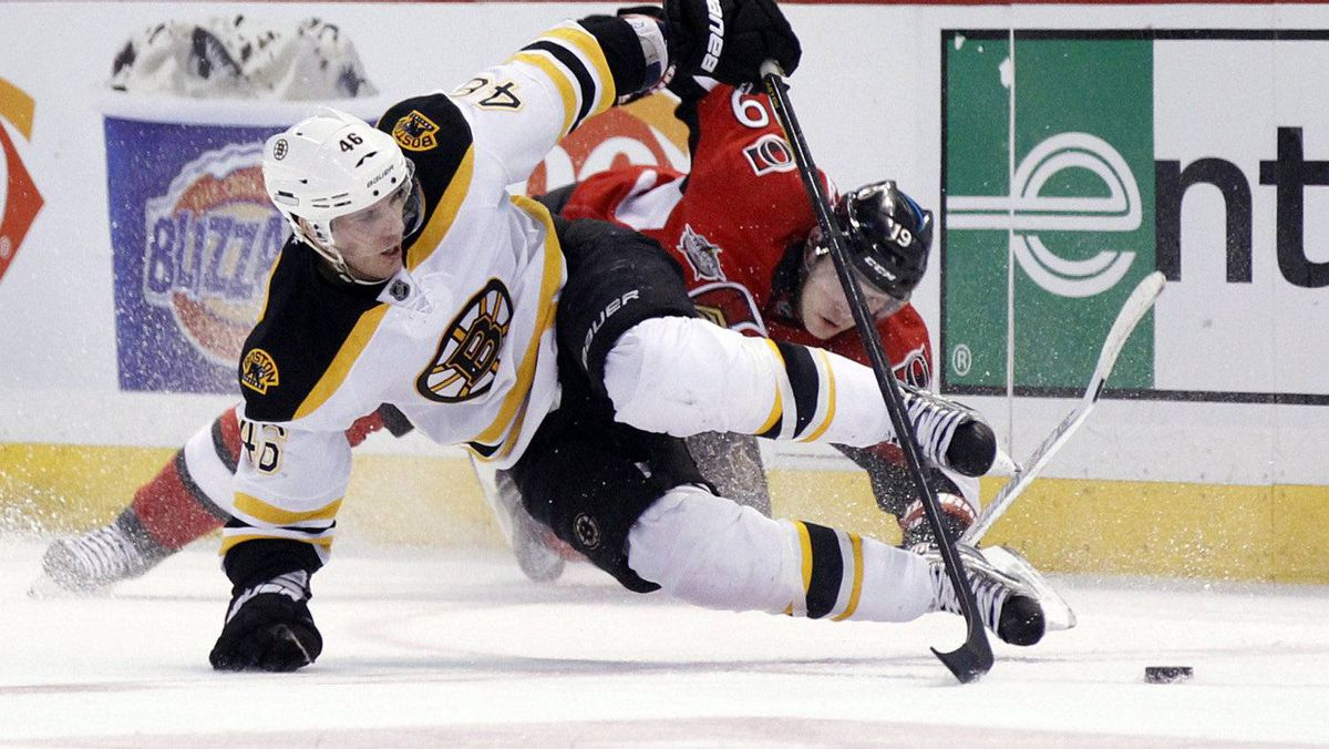 Boston Bruins' David Krejci (front) gets tangled up with Ottawa Senators' Jason Spezza during the second period of their NHL hockey game in Ottawa February 25, 2012. The Bruins won 5-3. REUTERS/Blair Gable
