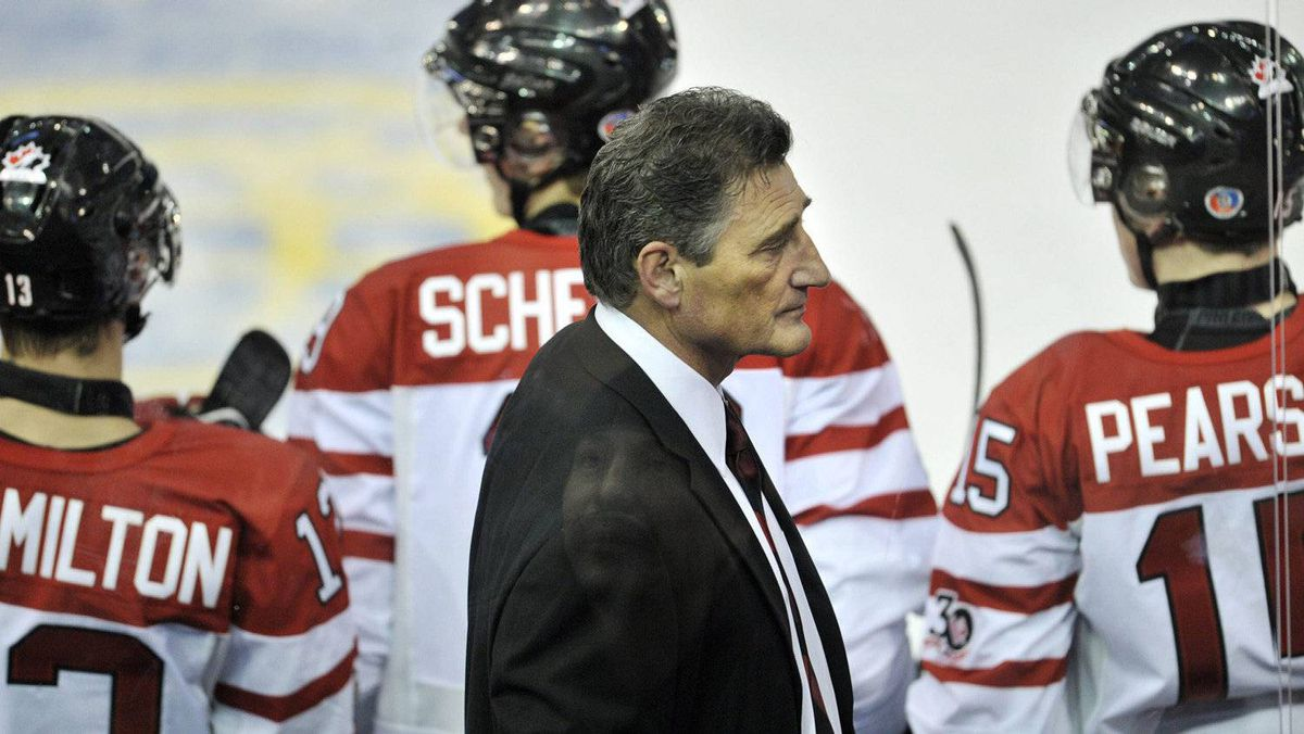 Team Canada head coach Don Hay, centre, stands behind the bench as they play against Team Finland during third period IIHF World Junior Championships hockey action in Edmonton, on Monday, Dec. 26, 2011. THE CANADIAN PRESS/Nathan Denette