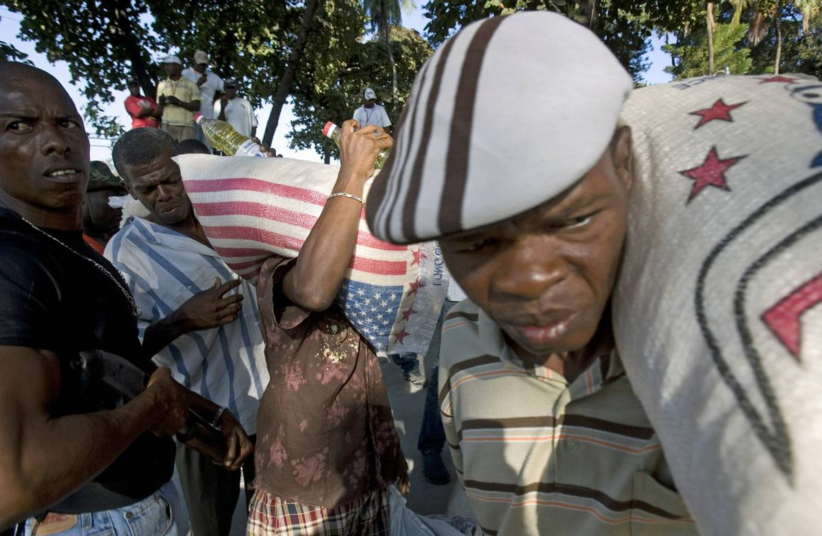 A shipment of rice, beans and vegetable oil from the United States and Canada is handed out by a relief agency in Port-au-Prince on Thursday, Jan. 21, 2010.