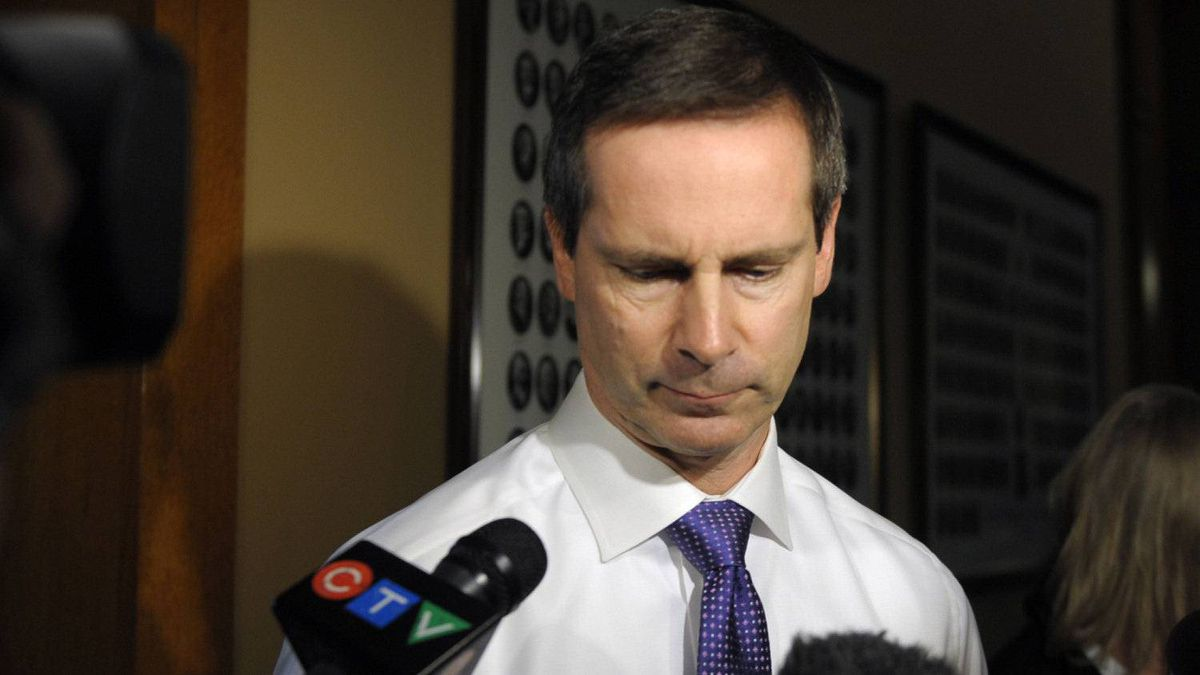 Ontario premier Dalton McGuinty is scrummed after a press conference by Ontario ombudsman Andre Marin that blasted the powers granted to police by McGuinty's during the G20 Summit in Toronto the past summer. Police had stated that people were not allowed within five metres of a security fence when in fact this was false and this info only came to light after the summit had already ended.
