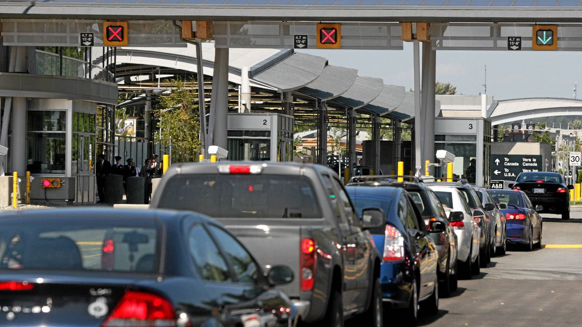 Vehicles line up to enter Canada from the United States at the Douglas border crossing on the Canada-USA border in Surrey, B.C., on Thursday August 20, 2009. The Douglas port of entry processes more than 2 million vehicles and 3 million travelers a year.