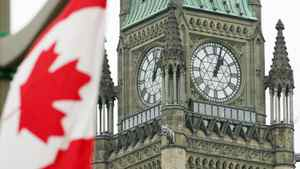 The Canadian flag flies in front of the Peace Tower on Parliament Hill in Ottawa Sunday, September, 2005.