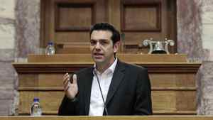Alexis Tsipras, leader of the Coalition of Radical Left, addresses parliamentarians in Athens on May 9. He declared that the 'barbarous' bailout agreement is now invalid, triggering blunt threats from several European politicians and officials.