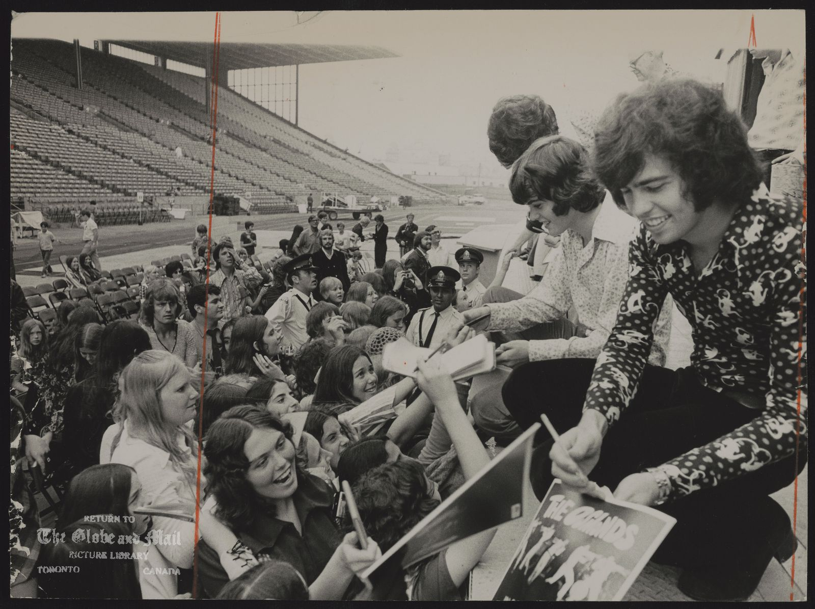 THE OSMONDS (vocal group) (Donny left and Alan Osmond signing autographs at the CNE yesterday.)