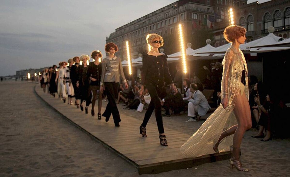 Models strut down the boardwalk during a recent showing of Chanel's cruisewear collection on the Lido in Venice. The Italian city was a favourite haunt of Coco Chanel, who went there in 1919 to get over the death of a lover.