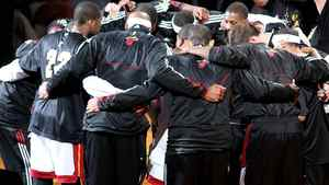 The Miami Heat huddle up on court. (Photo by Marc Serota/Getty Images)