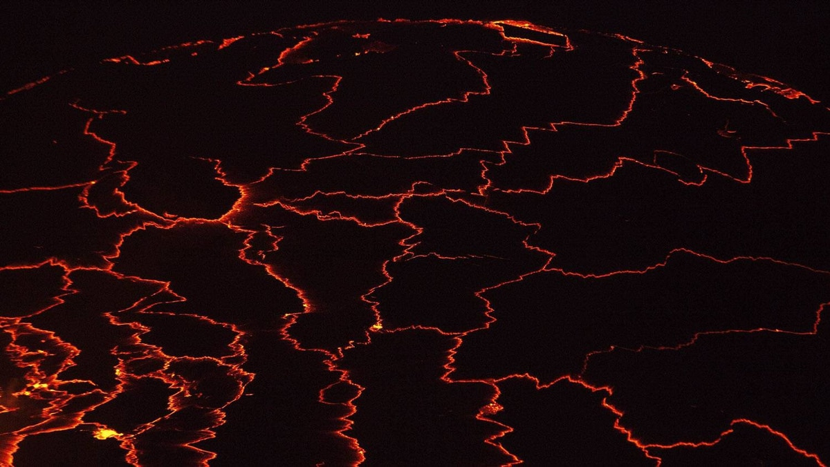 A lava lake with a diameter of 300 meters (500 feet) glows at night in the crater of Nyiragongo volcano near Goma in eastern Congo, August 30, 2010.
