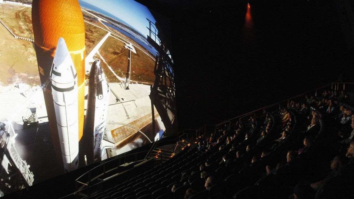 "An audience watches ""The Dream is Alive"" film at the IMAX Theater at Smithsonian National Air and Space Museum in Washington April 4, 2012."