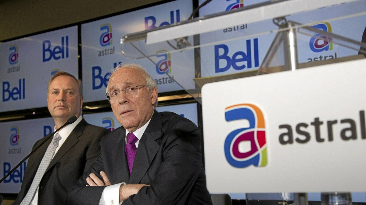 Bell Canada Enterprises chief executive officer George Cope, left, and Ian Greenberg, CEO of Astral Media Inc., speak at a news conference to announce their merger deal.