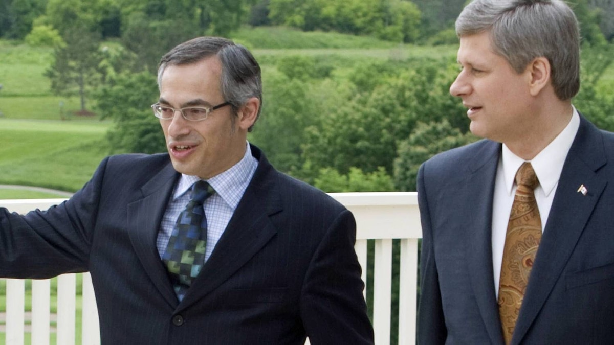 Prime Minister Stephen Harper walks with Industry Minister Tony Clement before making an announcement in Huntsville, Ont., on June 19, 2008.