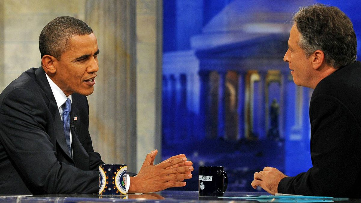 U.S. President Barack Obama chats with Daily Show host Jon Stewart during a commercial break in taping on Oct. 27, 2010 in Washington.