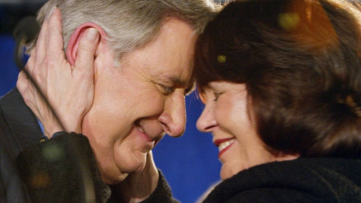 Mr. Klein and his wife Colleen embrace at his campaign headquarters after winning a fourth consecutive majority government on Nov. 22, 2004.