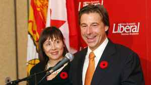 New Brunswick Liberal Leader Shawn Graham holds a news conference on Tuesday, Nov.9, 2010 announcing that he is stepping down as the party's leader in Fredericton, Tuesday, November 9, 2010 as his wife Roxanne Reeves looks on.