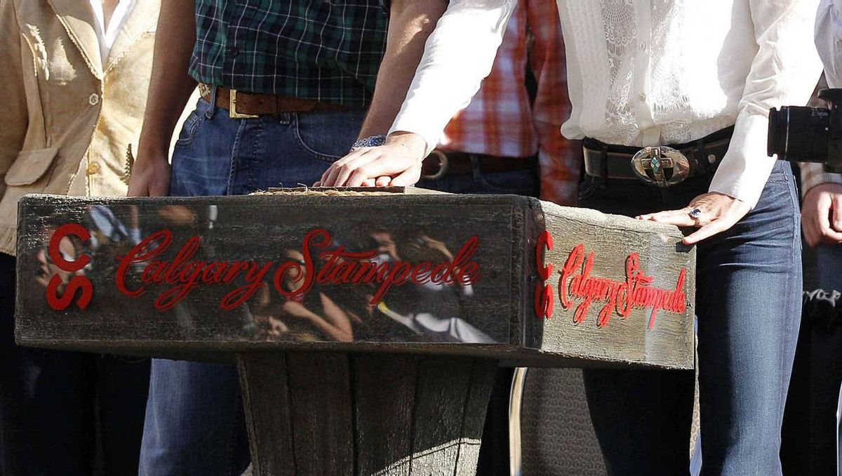 Prince William and his wife Catherine, Duchess of Cambridge, press a button to launch fireworks and officially start the Calgary Stampede parade in Calgary, Alberta, July 8, 2011.