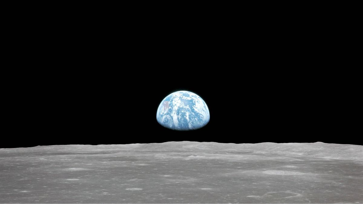 Apollo 11 Mission imag : vew of the moon limb, with Earth on the horizon
