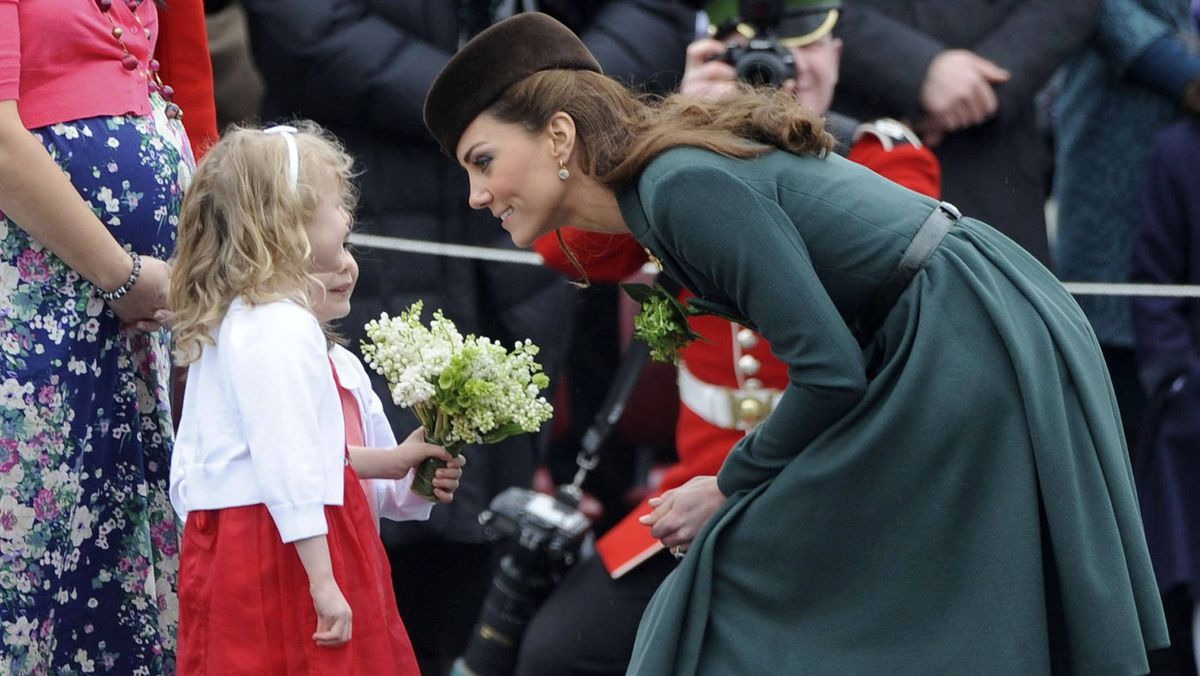 Catherine, Duchess of Cambridge, greets two children at the Aldershot military base in southern England on Sunday for a St. Patrick's Day traditional event.