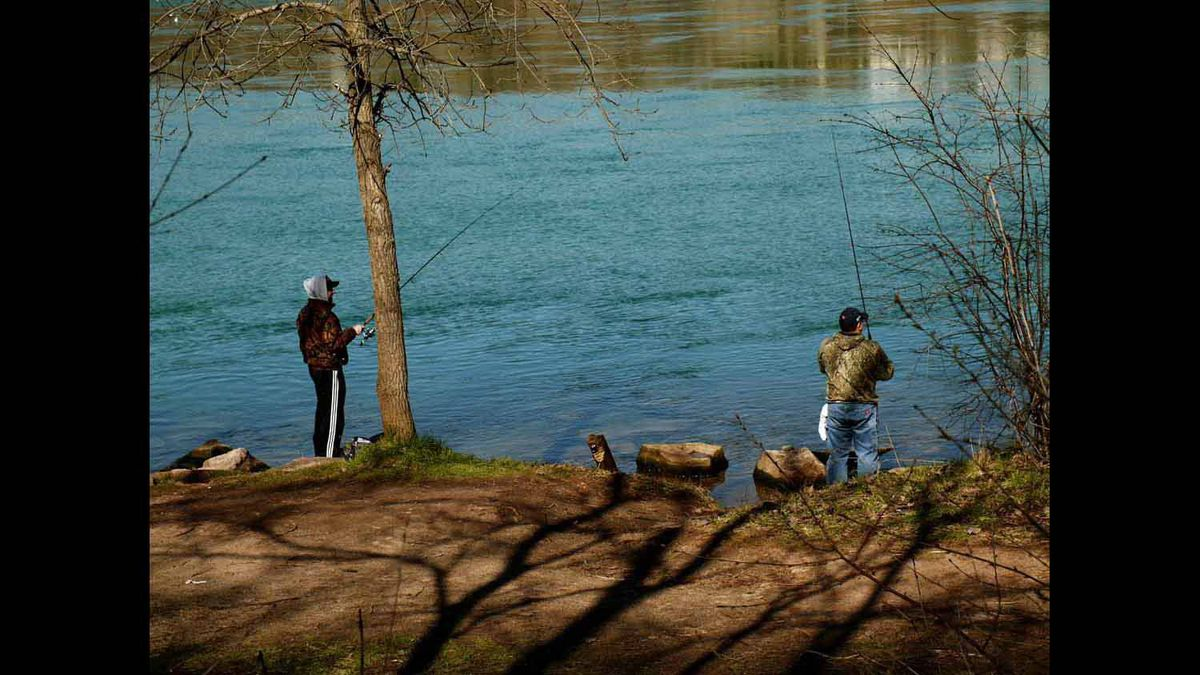 April 2 - Niagara River provides a beautiful backdrop for these fine fishermen.