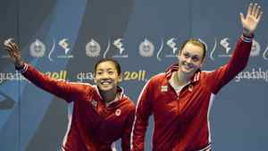 Canadian double's pair Alex Bruce, right, and Michelle Li, left, wave to the crowd while receiving gold after defeating the United States doubles Badminton during the 2011 Pan American Games in Guadalajara, Mexico on Wednesday, Oct. 19, 2011.