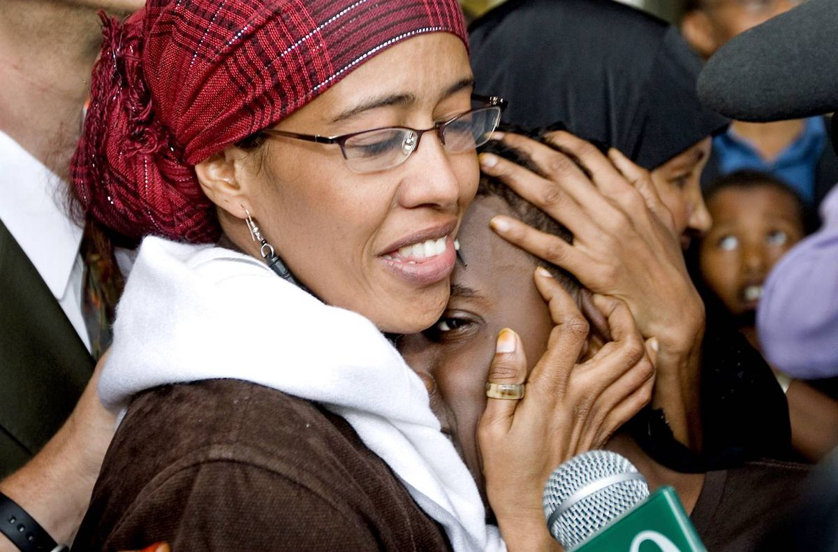 Suaad Hagi Mohamud embraces her 12-year-old son upon arriving at Pearson airport in Toronto on Aug. 15, 2009, after a three-month ordeal in Kenya.