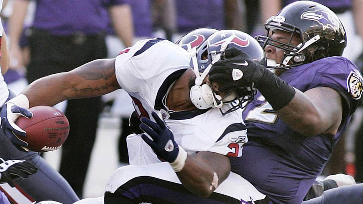 Baltimore Ravens' nose tackle Terrence Cody makes the tackle on Houston Texans' running back Arian Foster for no gain on a fourth and one play during the second quarter of their NFL football game in Baltimore.