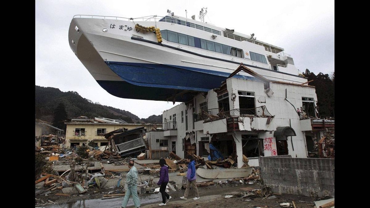 A boat sits atop a building in Otsuchi, Iwate Prefecture, Japan, following the March 11 earthquake and tsunami which devastated a vast area of northeastern Pacific coast of Japan, March 22, 2011.