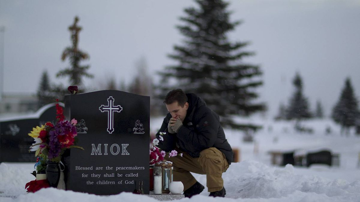 Cpl. Jesse Starko pauses for a moment as he visits the gravesite of friend and colleague Sgt. George Miok at the Our Lady of Peace cemetery in Edmonton, Dec 10, 2010. He would have normally been in the vehicle at the time of the bombing but was cut from the patrol at the last minute to make space for Calgary journalist Michelle Lang, who also died in the blast.