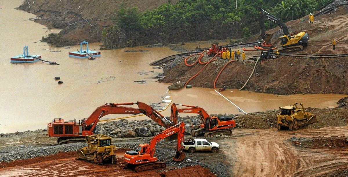 Barrick Gold workers repair a dam affected by rains in the Dominican Republic earlier this year.