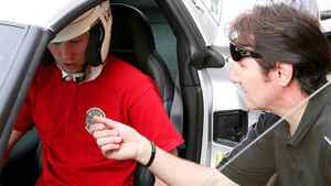Craig Anderson takes lessons from Ron Fellows at his Corvette driving school