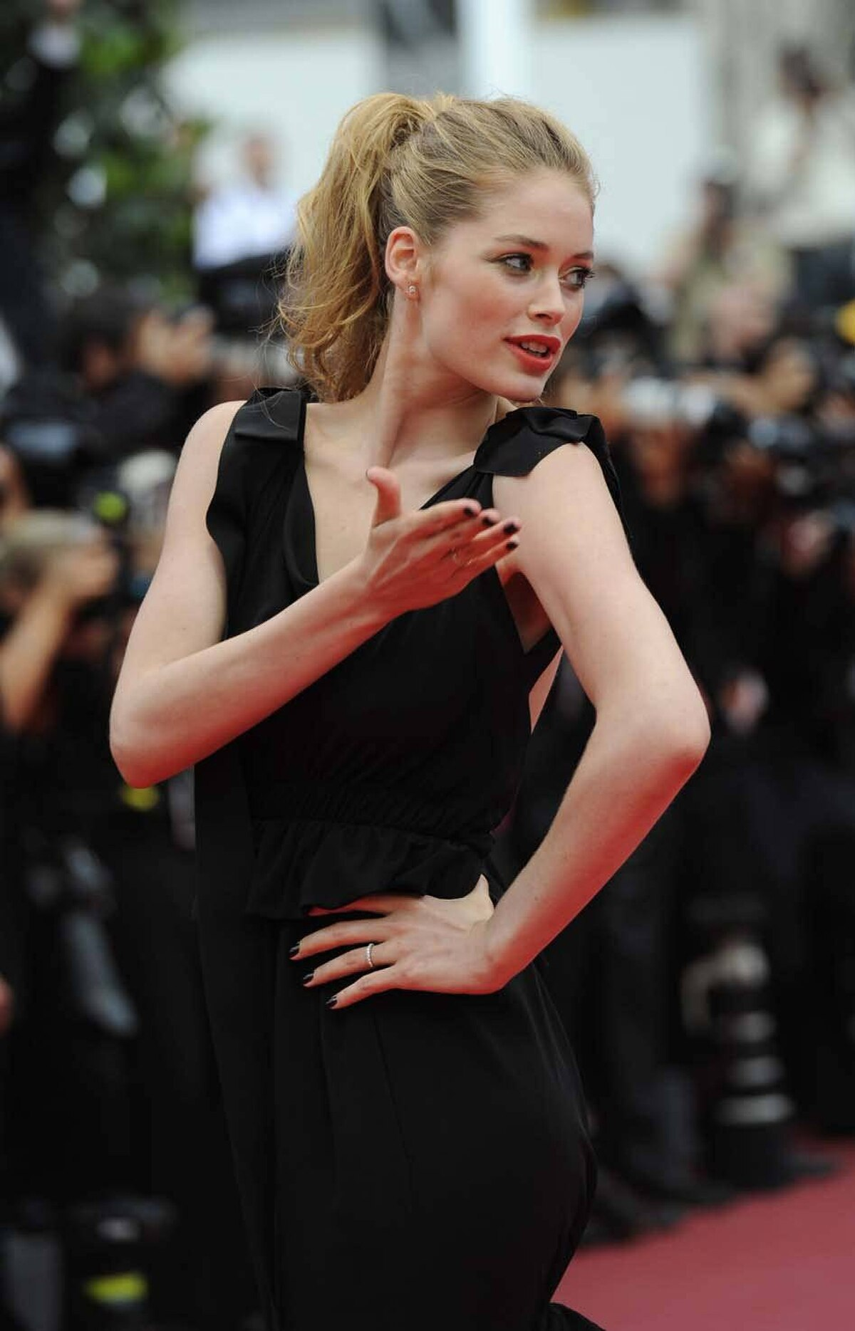 """Dutch model Dousten Kroes returns fire on the red carpet before the screening of """"La Conquete"""" at the Cannes Film Festival on Wednesday."""