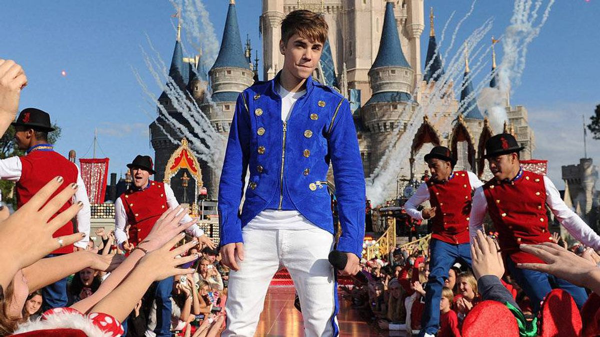 """Justin Bieber performs a medley of songs from his new holiday album while taping a performance segment for the """"Disney Parks Christmas Day Parade"""" TV special at the Magic Kingdom park."""