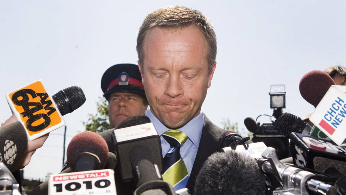 Former Ontario attorney-general Michael Bryant talks to media outside the Toronto Police Traffic Services on Tuesday, September 1, 2009. Bryant has been charged with criminal negligence causing death and dangerous operation of a motor vehicle causing death after a cyclist was killed.