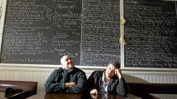 David McMillan (L) and Fred Morin, co-owners of the restaurant Joe Beef , sit in their restaurant, October 17, 2011.