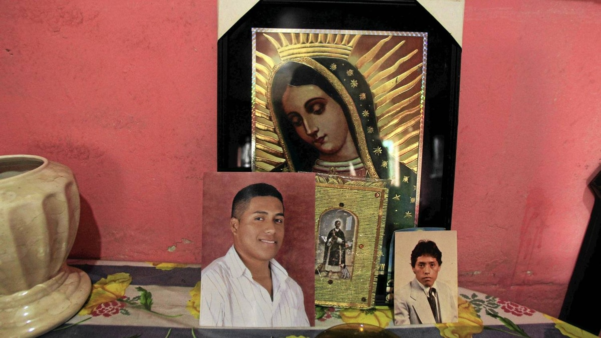 Photos of Jose Valdiviezo (R) and his son Fernando Valdiviezo are displayed at home in Comas. Jose and his son Fernando were killed in the crash accident