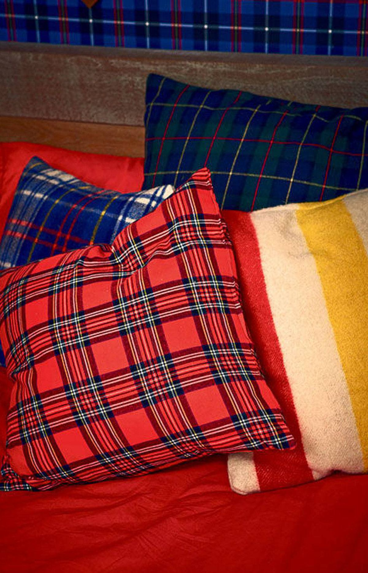 Foelske used tartans in contrasting colours to create an array of large throw pillows.