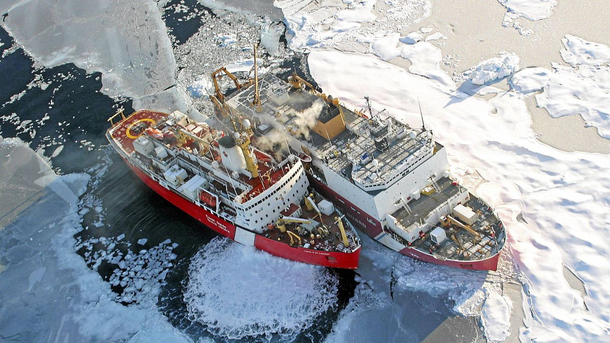 A helicopter view of the Canadian Coast Guard ship Louis S. St. Laurent, left, and the U.S. Coast Guard Cutter Healy on the Arctic Ocean.
