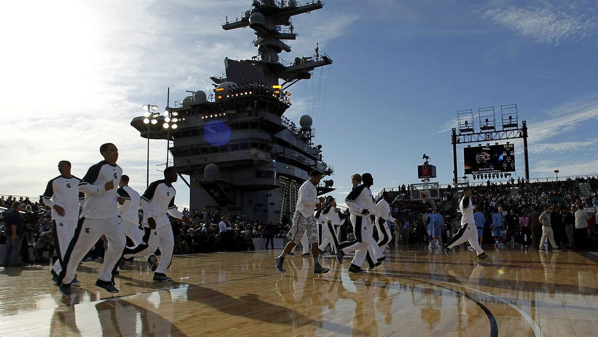 Michigan State Spartans warm up before their game against the North Carolina Tar Heels at the NCAA Carrier Classic men's college basketball game on the deck of aircraft carrier USS Carl Vinson in Coronado, California November 11, 2011. REUTERS/Mike Blake