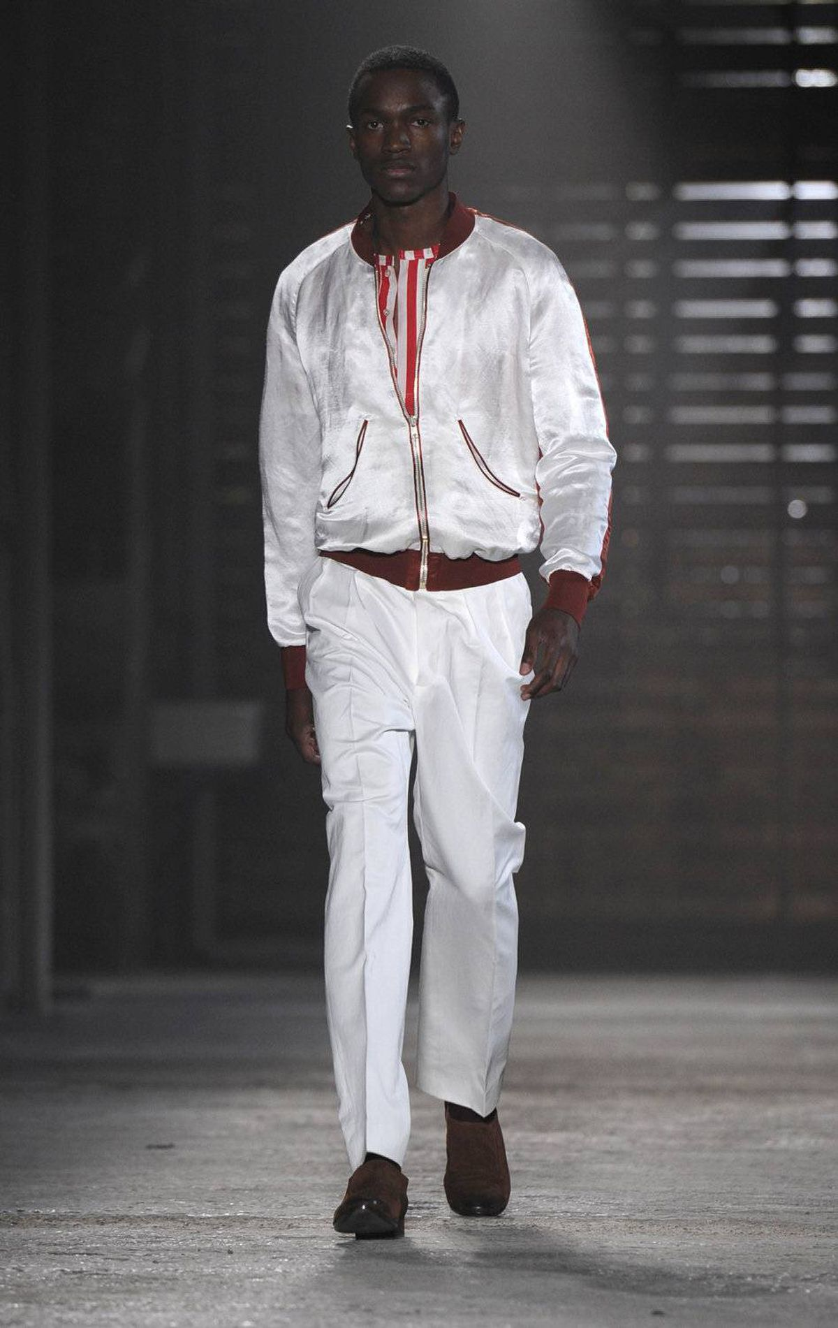A model displays a creation as part of the Alexander McQueen spring-summer 2012 men's wear collection on June 20, 2011 during the men's fashion week in Milan.