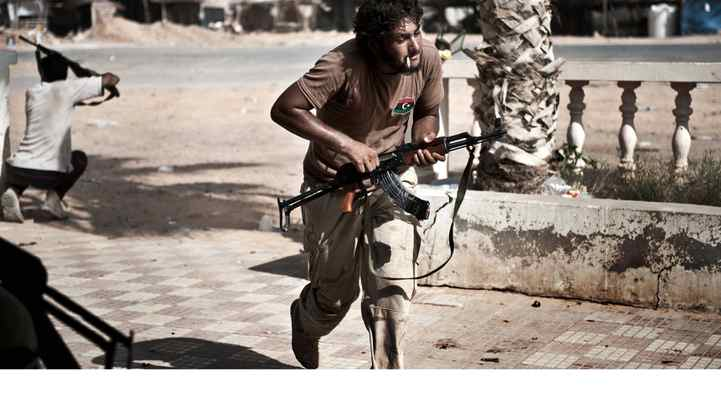 Libyan rebels come under fire from Gadhafi loyalists in Bir Ghanam, southwest of Tripoli.