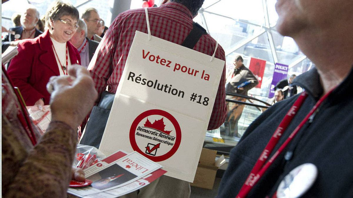 Liberal Party members from Oakville, Ontario wear sandwich boards and pass out flyers supporting their Resolution at the Liberal Convention in Ottawa. Resolution 18 calls for an elected Democratic Renewal Commission with a two-year mandate to broadly consult the party's membership and table a comprehensive set of constitutional amendments at the first subsequent national convention.
