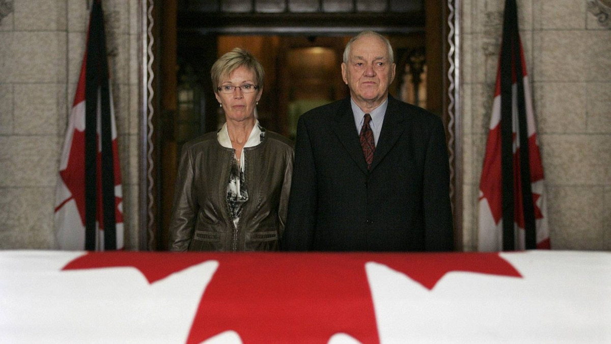 Former leader of the NDP Ed Broadbent (R) and interim leader of the NDP Nycole Turmel pay their respects.