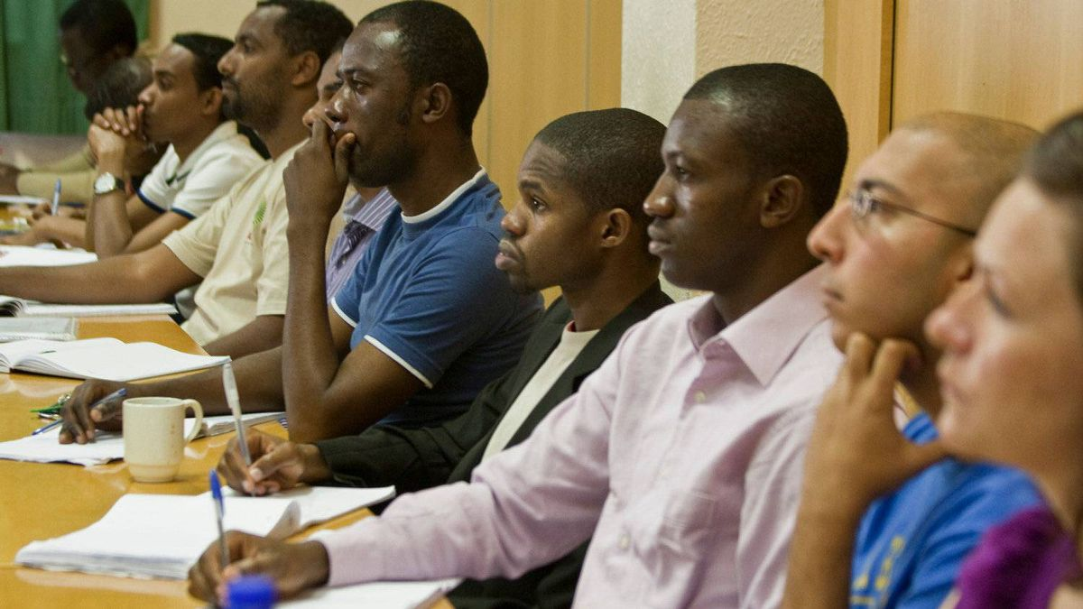 Students at the African Institute for Mathematical Sciences attend a lecture on experimental mathematics using Sage, a software system. Many of the students, who come from countries all over Africa, must take English classes in addition to math and sciences.