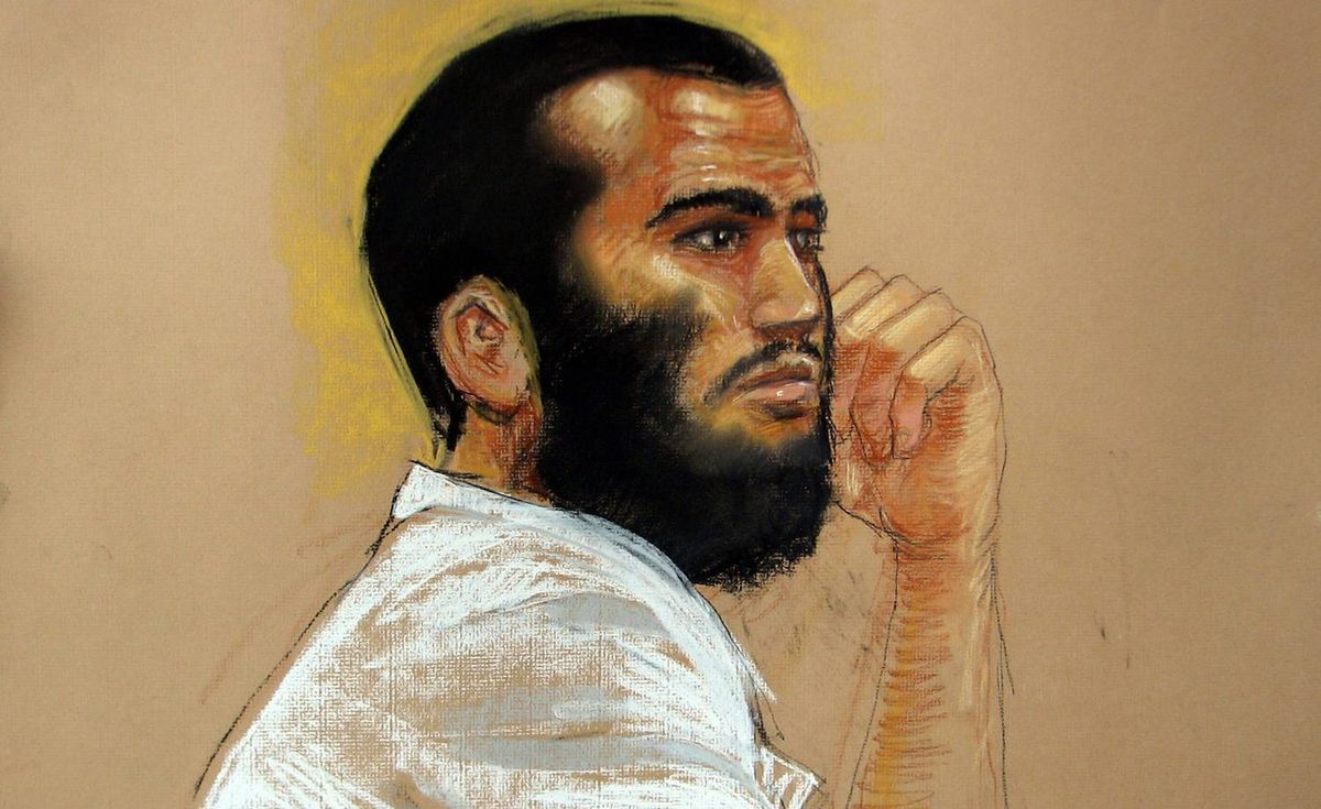 In this photo of a sketch by courtroom artist Janet Hamlin and reviewed by a U.S. Department of Defense official, Canadian defendant Omar Khadr attends his hearing in the courthouse for the U.S. military war crimes commission at the Camp Justice compound on Guantanamo Bay U.S. Naval Base in Cuba, Wednesday, April 28, 2010.