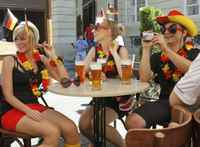 Young German soccer fans sit in a bar in central Lviv June 17, 2012.