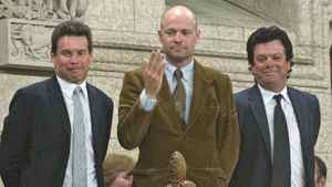 Tragically Hip lead singer Gordon Downie blows a kiss alongside bandmates Gord Sinclair (left) and Paul Langlois as they are recognized by the Speaker in the House of Commons on Parliament Hill in Ottawa, May 1, 2008.